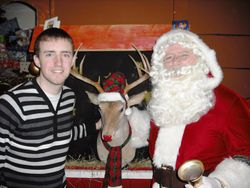 Michael with Santa in the grotto