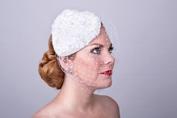 Heart shape fascinator with veil;