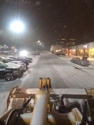 Loader plowing snow