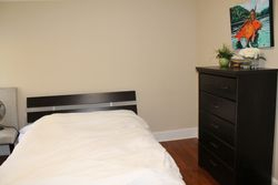 Bed and Dresser area