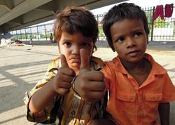 14 Their tawny brown hair suggests these two homeless street kids are suffering from malnutrition