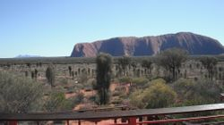 Ayers Rock from the Sunrise Viewing Areawith the Olgas in the background