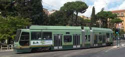 Socimi Low Floor Car #9027 arriving at the Ministero Marina stop.