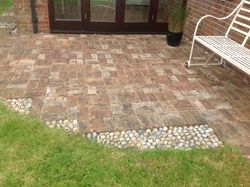 Brick built patio area with stone insets