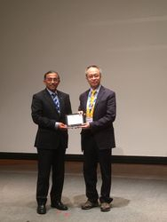 Prof John Woo, President of the Hong Kong College of Otolaryngologists receiving the speaker's plaque from Shahed Quraishi