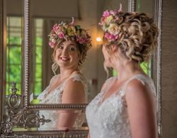 Beautiful bridal hair soft romantic curls and elegant updo with Flower Crown