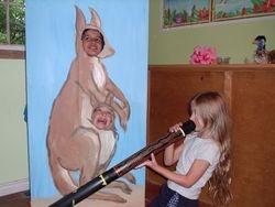 The kangaroo and joey enjoy the digeridoo