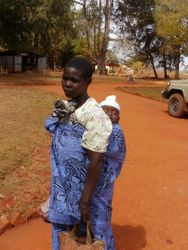 The infant is wearing a baby hat made by a GV volunteer.  The baby got the hat when they visited the Medical Clinic