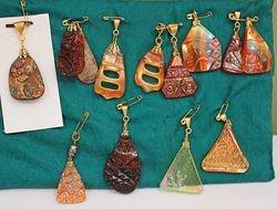 Pendants made from broken carnival glass
