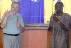 Linus teaching with Pastor Peter.
