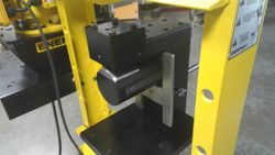Custom fabricated hole punch fixture.