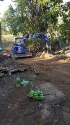 Digger at work in farm