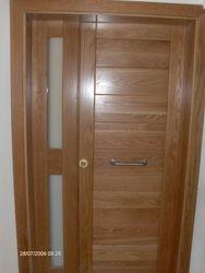 Main door in solid oak and stainless steel handle