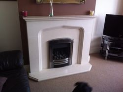 Inset Gas Fire an Limestone Fire Surround Installation. 1.