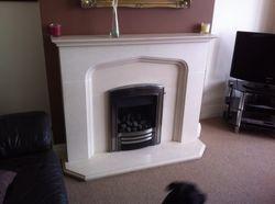 Inset Gas Fire an Limestone Fire Surround Installation. 1.