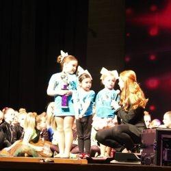 Mini Cheer - Answering questions at Awards