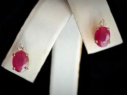 Oval ruby studs with diamond accent