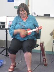"Kerry playing her ""Christmas"" ukulele"