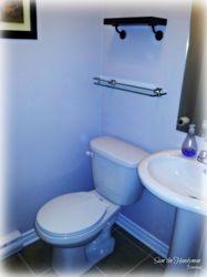 Bathroom wall shelving installed