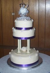 Purple Ribbon lined Wedding cake with Flowers