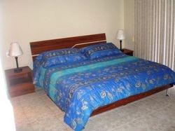 Dormitorio con cama queen 2.5 plazas