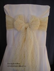 Ivory bow with nude voile.