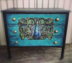 Stunning peacock design on drawers