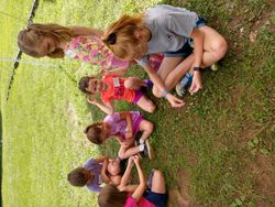 Hailey making flower bracelets with the girls!