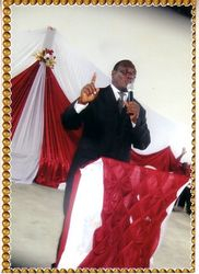 Pastor Kimbe preaching the word of God.