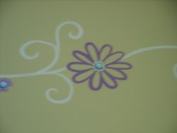 floral/swirl pattern with rhinestone centers