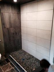 Stone tiles shower base