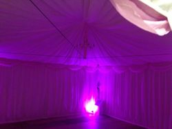 Marquee linings lit pink with uplighters