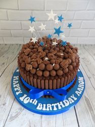 Blue and white malteser cake