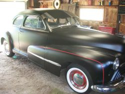 8.47 Oldsmobile series 66 coupe.