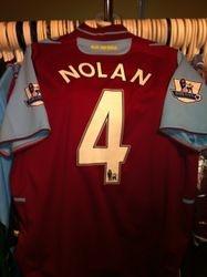 Captain Kevin Nolan's poppy shirt
