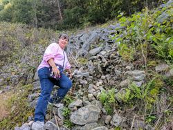 Debbie Mooney posing on rugged terrain (Bald Eagle Mountain).