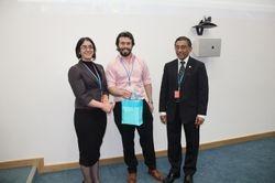 Quiz prize winner: Stephen Ridley (center)