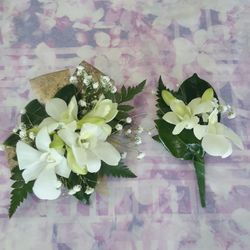 White Singapore corsage with matching button hole