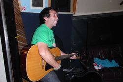 Ross playing his guitar during the recording
