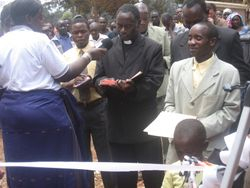 Several Lutheran pastors read prayers at the dedication.  The woman with the microphone is from the Diocese radio station in Iringa
