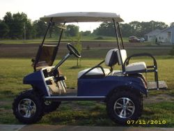 "2006 Club Car Gas with new body, 6"" lift, tires and wheels, rear flip seat"