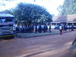 Secondary School students unloading pipe at the Mission House