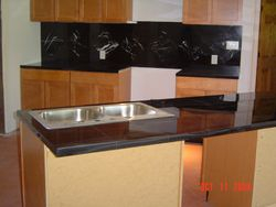 Black Granite Tile With Marble Accents