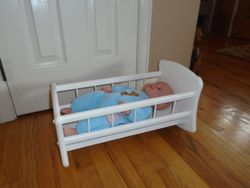 Wood Doll Cradle with Soft-Bodied Doll - $20