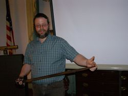 John Ackner demonstrated the sword.