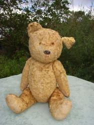 Vintage teddy needing facial surgery
