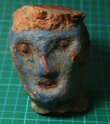 Crude pottery head Westlake
