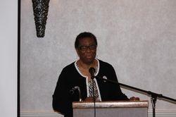 Elder Margaret Allen greets the audience