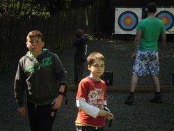 Calum and Taylor waiting for their turn at archery