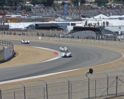 1959 Lister Costin leads 1960 Lotus 19 at turn 2